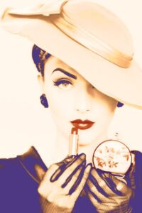 1930's glamour with lipstick and compact mirror